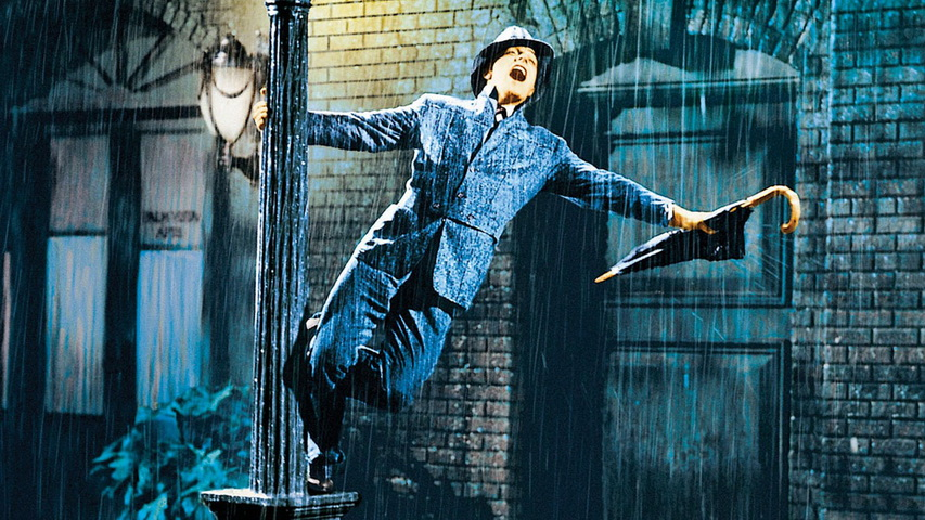 Кадр из фильма «Поющие под дождем»